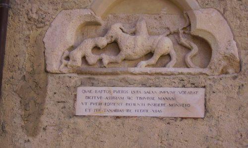 La Lupa di S. Francesco. Bassorilievo del XIII sec. (A lato Duomo di Alessandria)