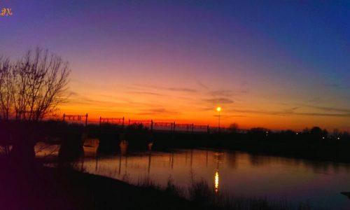 Il ponte ferroviario di Alessandria al tramonto